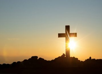 Resurrection concept:Crucifixion Of Jesus Christ Cross At Sunset